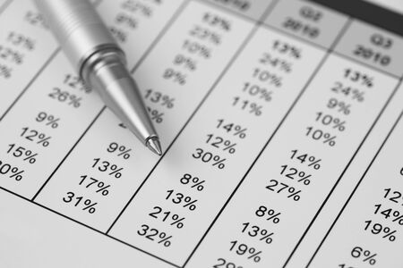 financial statements: Ballpoint pen on financial statements. (Black and white). Close-up. Stock Photo