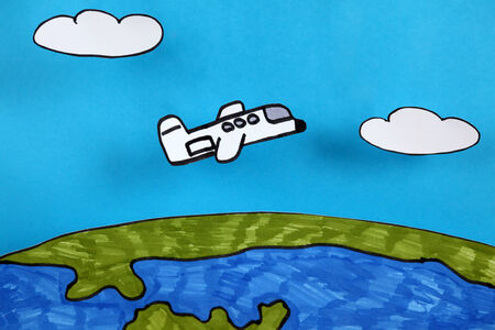 child's: Airplane flies over planet Earth. Like childs drawing style. Image was hand drawn and cut-out paper by myself. Stock Photo