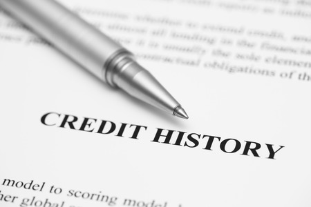 black history: Credit History. Ballpoint pen on Credit History (Credit Report). Focus on the end of ballpoint pen. Shallow depth of field. Black and White. Close-up. Stock Photo