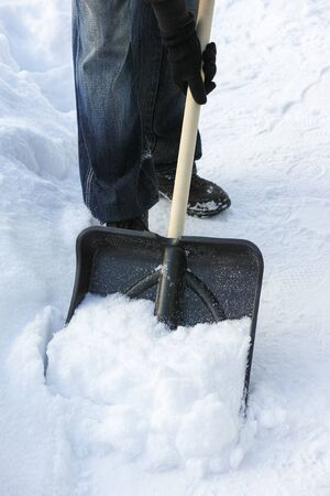 snow drift: Shoveling snow.