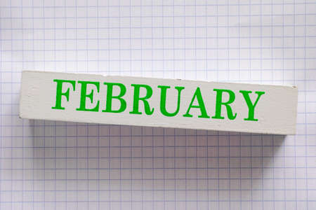 wooden block: February month printed on wooden block.