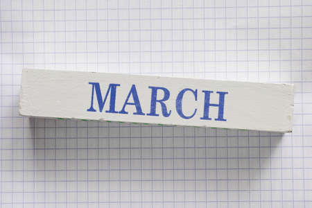 month: March month printed on wooden block.