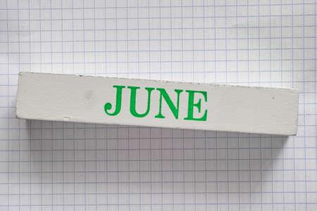printed: June month printed on wooden block.
