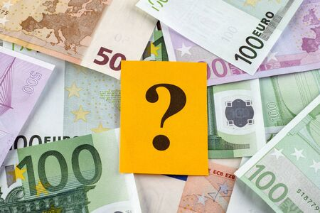 one hundred euro banknote: Question mark on euro banknotes. Stock Photo