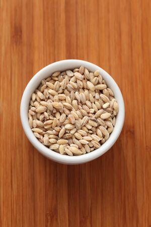 pearl barley: Pearl barley in a bowl. Close-up. Stock Photo