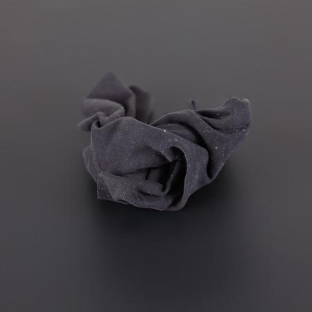 dusty: Black dusty rag on a black background. Stock Photo