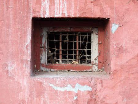 basement: Window of an abandoned basement.