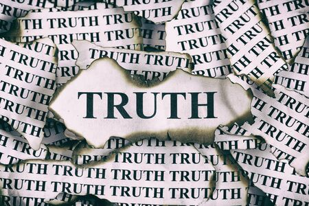 burnt: Burnt Truth. Burnt pieces of paper with the word Truth