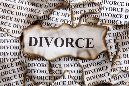 divorce: Burnt Divorce. Burnt pieces of paper with the word