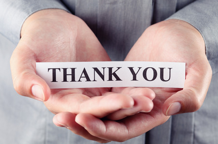 Piece of paper with the words Thank You Stockfoto