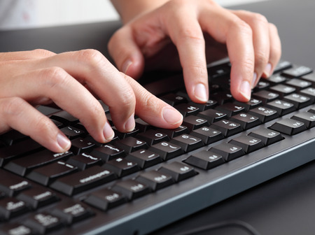 Woman typing on keyboard. Imagens