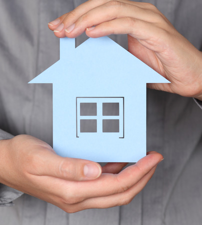 womans hands: Paper House in womans hands.