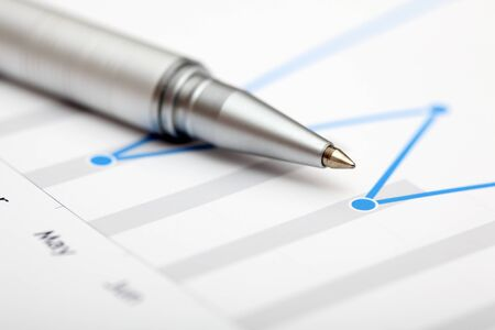 ballpoint pen: Chart with ballpoint pen. Focus on the end of ballpoint pen. Shallow depth of field. Close-up. Stock Photo
