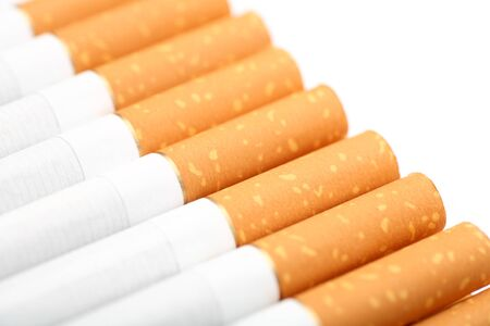 unhealthy living: Close-up of filter tipped cigarettes. Shallow depth of field.