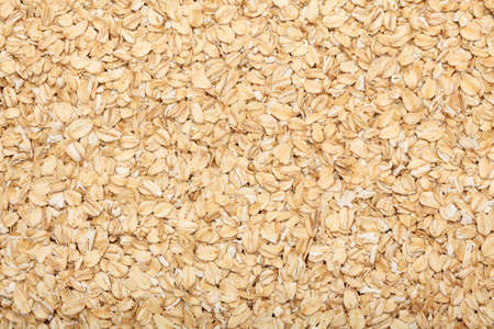 rolled: Rolled oats background. Close-up.