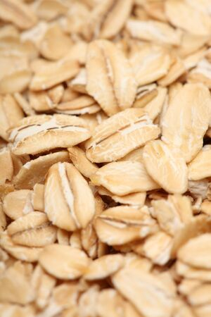 food staple: Rolled oats background. Close-up.