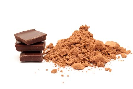 cocoa powder: Chocolate and cocoa powder on white background. Close-up.