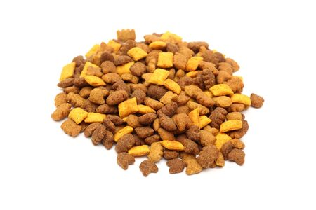 dried food: Heap of cat dried food on white background. Shallow depth of field.  Close-up. Stock Photo
