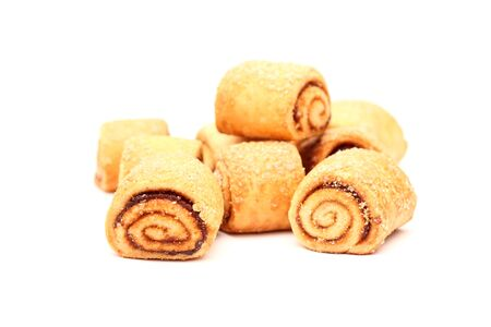 stuffing: Small Swiss Rolls with apple stuffing on white background. Shallow depth of field. Close-up. Stock Photo