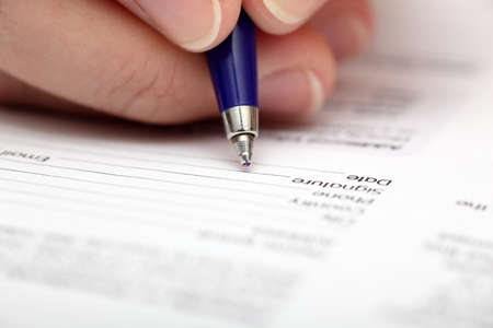 ball point: Businesswoman signing contract. Focus on ball point pen. Close-up.