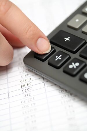 financial statements: Calculating on a calculator. Financial statements. Close-up. Stock Photo