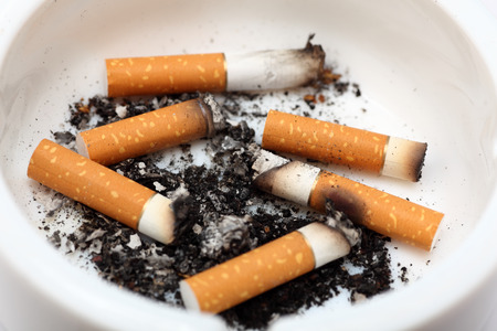 bad habit: Cigarette butts in an ashtray. Close-up. Stock Photo