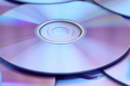 DVDs background. Shallow depth of field. Close-up.