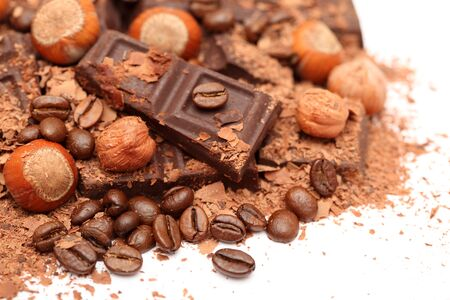 Chocolate, hazelnuts and coffee beans. Close-up.