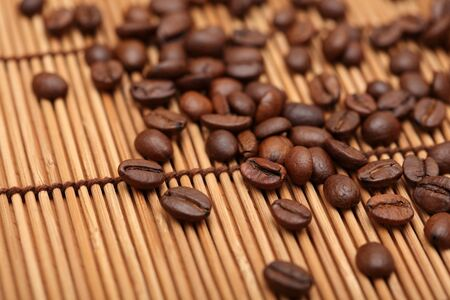 large bean: Coffee Beans on bamboo napkin. Shallow depth of field. Close-up.