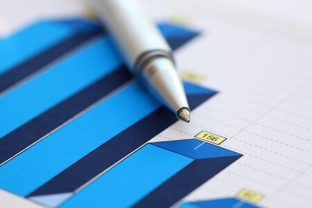 financial statements: Financial statements. Business Graph. ballpoint pen on a financial chart or Stock Market Data. Focus on ballpoint pen. Close-up. Stock Photo