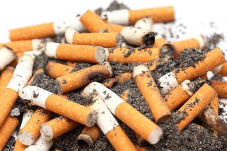 unhealthy living: Cigarette butts heap. Unhealthy habit. Close-up.