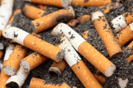 habit: Cigarette butts. Unhealthy habit. Close-up. Stock Photo