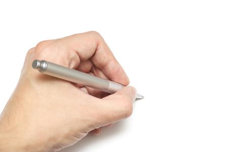 ボール ポイント ペンを持っている若い男の手