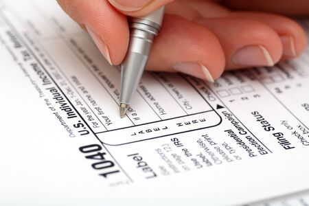 filling out: Filling out 1040 Tax Form. Close-up. Stock Photo
