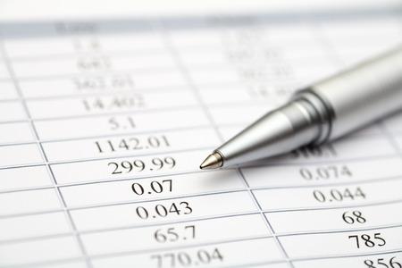 account statements: Financial statements. Ballpoint pen on financial statements. SDOF. Close-up.