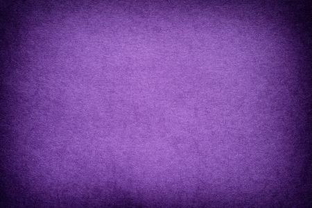 Paarse papier achtergrond met vignet. Stockfoto