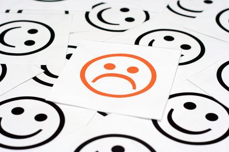 悲しそうな顔、幸せそうな顔 写真素材