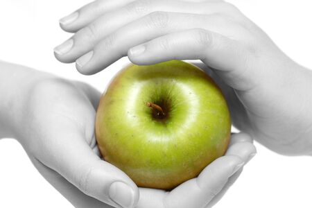 hand care: Green apple in careful hands. Black and white version. Stock Photo