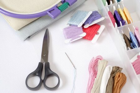 preparations: Preparations for embroidery Cross-Stitch. Close-up. Stock Photo
