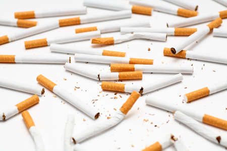 bad habit: Scattered cigarettes close-up. Stock Photo