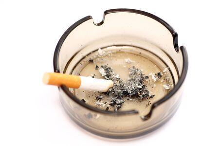 ashtray: Ashtray and cigarette close-up. Stock Photo