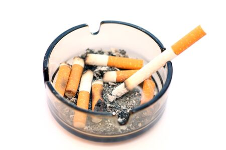 cigarette smoke: Ashtray and cigarettes close-up.