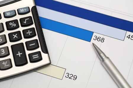 financial statement: Calculator, pen and financial statement. Close-up.