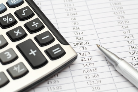 financial figures: Calculator, ballpoint pen on financial statements Stock Photo
