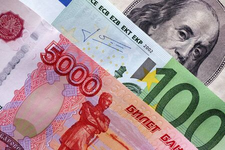 one dollar: Five thousand rubles, One hundred euro, One hundred dollars. Closeup.