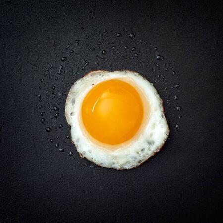 quail egg: Fried quail egg. Closeup. Vignette. Stock Photo