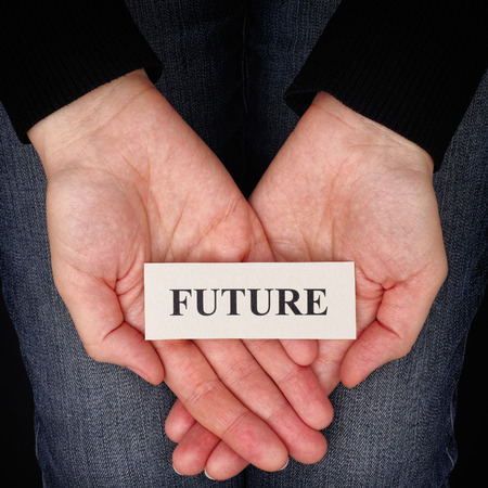 Woman holding word Future in her palms.