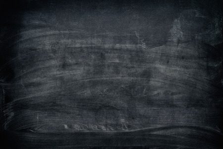 Black dirty chalkboard background. Vignette.