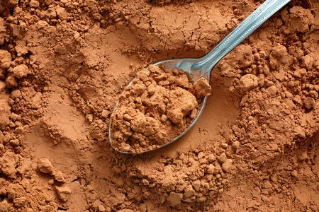 cocoa powder: Cocoa powder with spoon. Raw organic product. Stock Photo