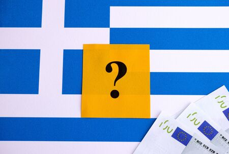 financial questions: Flag of Greece with question mark and one hundred euro banknotes. Crisis concept.
